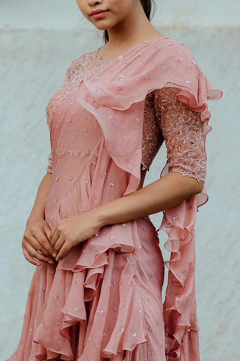 Blush pink pre-draped saree with layered ruffles. Comes with floral motif worked blouse