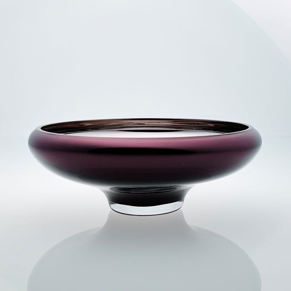 Purple glass bowl on a connected stand. Designer glass bowl with metal coating. Mirror effect glass bowl.