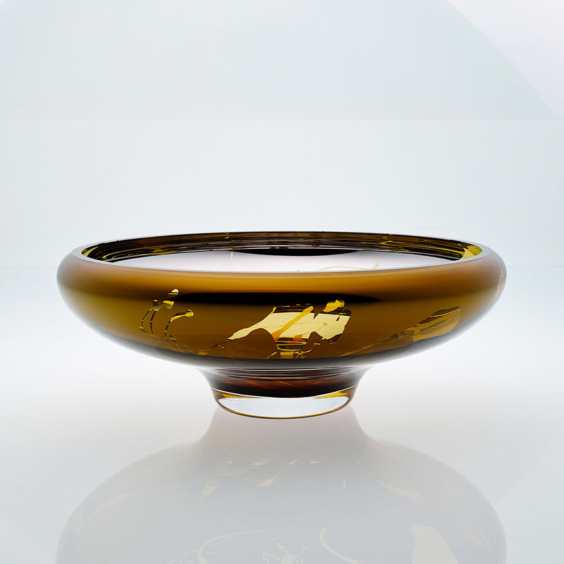 Amber glass bowl with splatter effect on a connected stand. Designer glass bowl with metal coating. Mirror effect glass bowl.