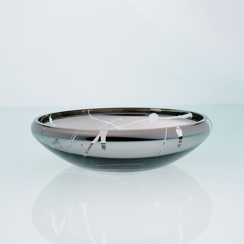 Flat round grey glass bowl with metal interior coating and splashes. Designer glass fruit bowl with mirror effect.