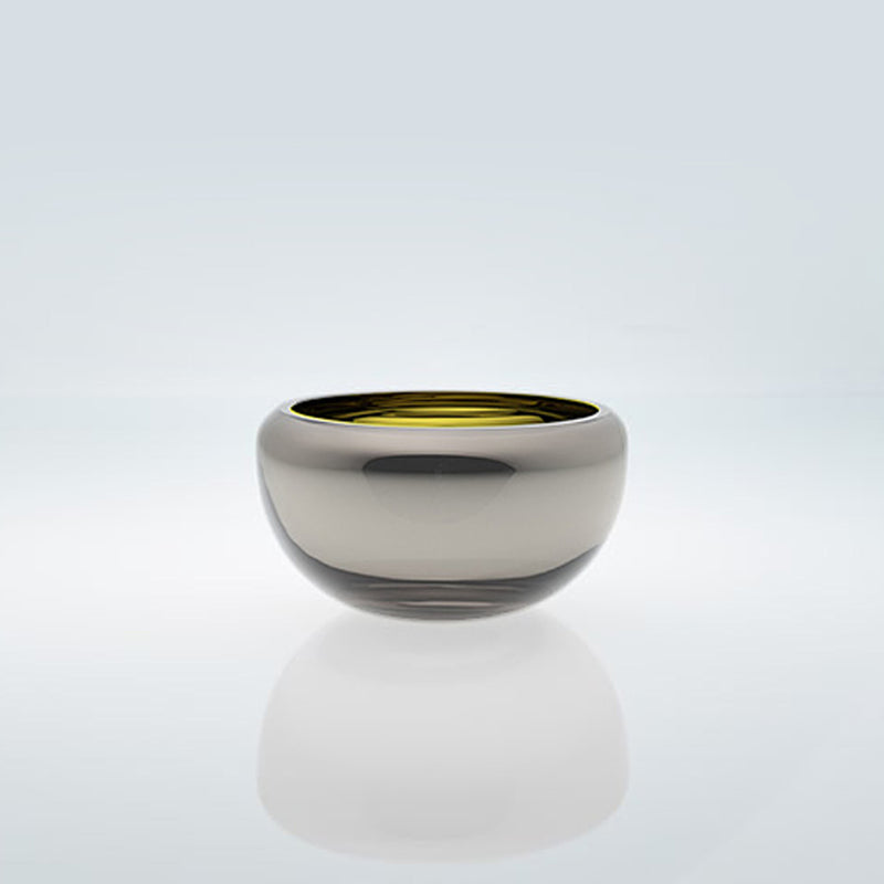 Small amber round glass bowl with exterior metal coating. Mirror glass effect bowl.