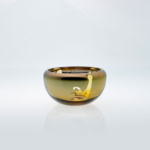 Small amber round glass bowl with splashed interior metal coating. Mirror glass effect bowl.