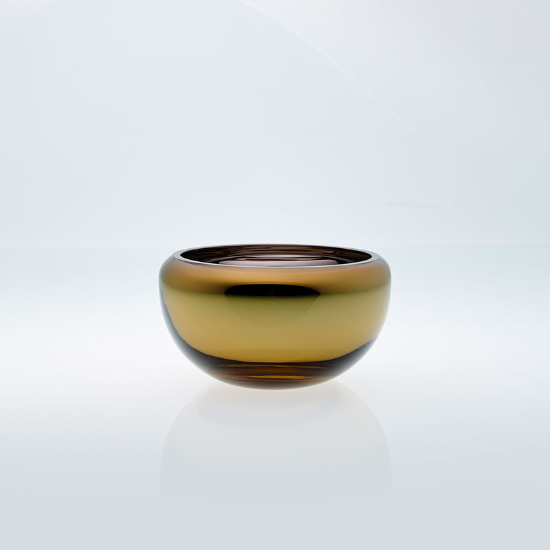 Small amber round glass bowl with interior metal coating. Mirror glass effect bowl.