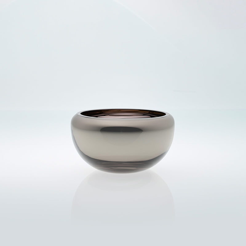 Small grey round glass bowl with interior metal coating. Mirror glass effect bowl.