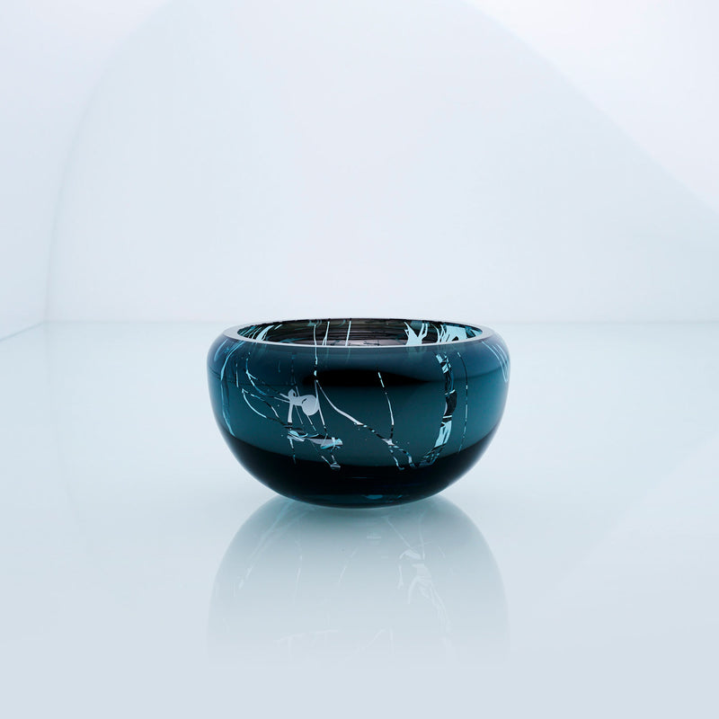 Small teal blue round glass bowl with splashed interior metal coating. Mirror glass effect bowl.