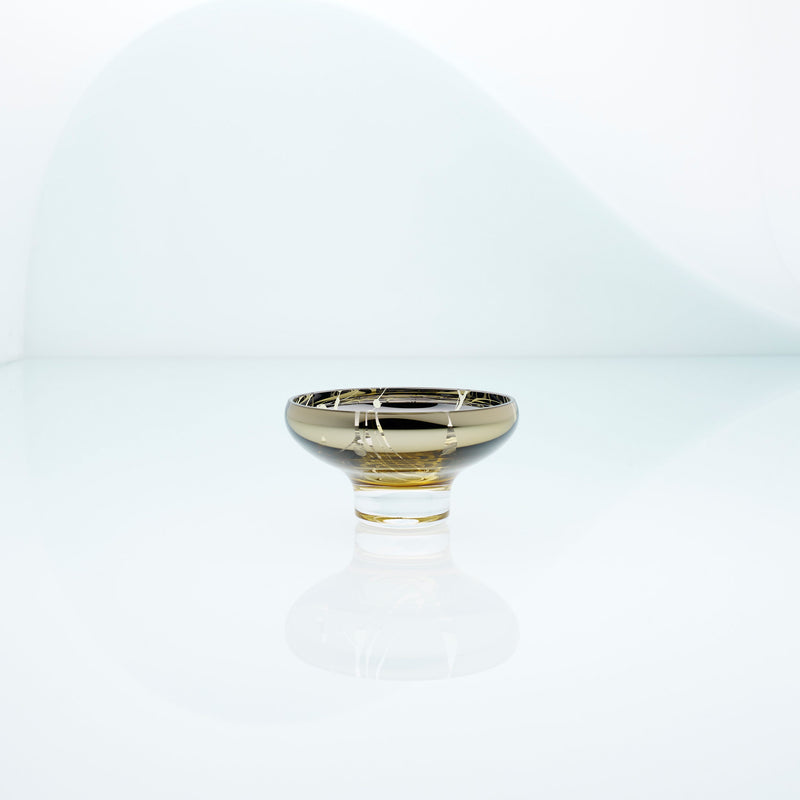 Golden amber glass mirror bowl with splashes and metal coating interior. Design dessert dish.