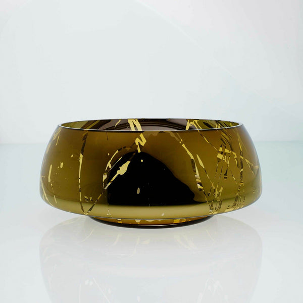Amber glass round bowl with high tops and splashes. Designer glass bowl with metal coating. Mirror effect glass bowl.