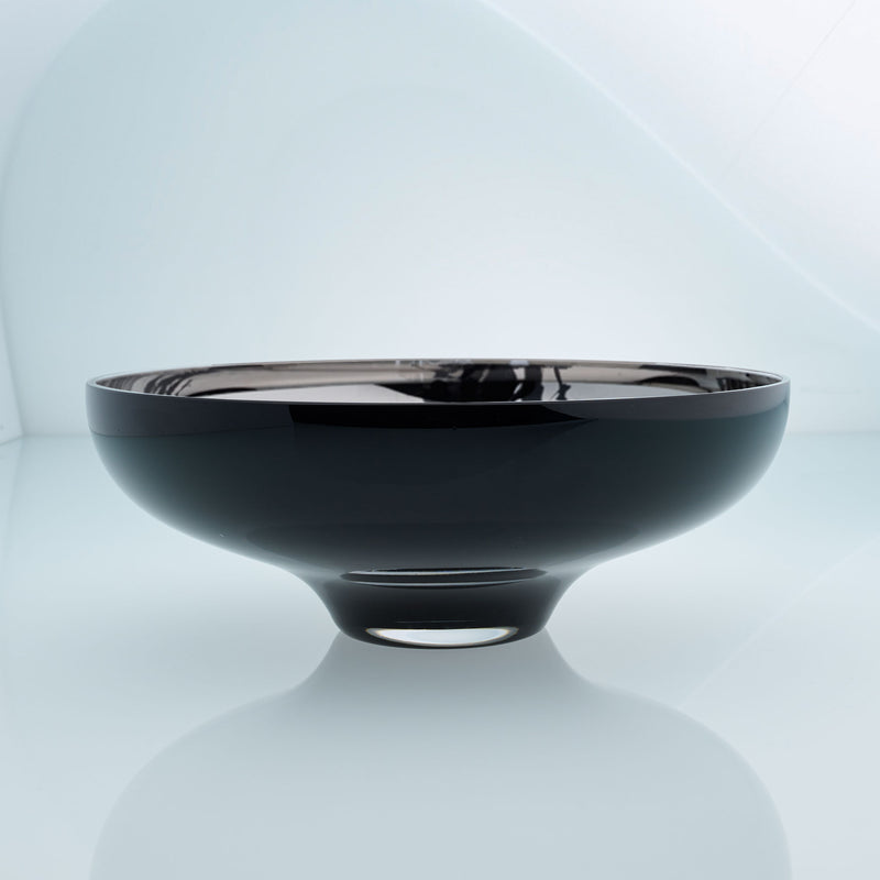 Round black glass fruit bowl on a stand with interior stainless steel coating and splashes. Mirror effect design glass bowl.