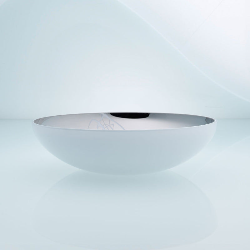 Flat round white glass fruit bowl with interior stainless steel coating and splashes. Mirror effect design glass bowl.