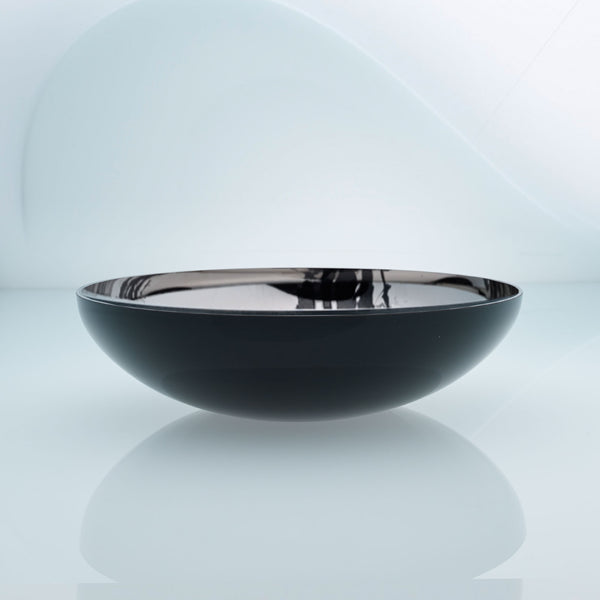 Flat round black glass fruit bowl with interior stainless steel coating and splashes. Mirror effect design glass bowl.