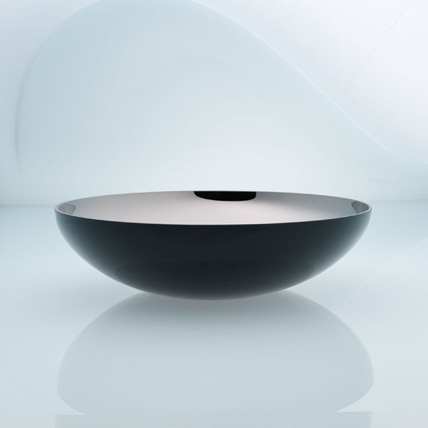 Flat round black glass fruit bowl with interior stainless steel coating. Mirror effect design glass bowl.