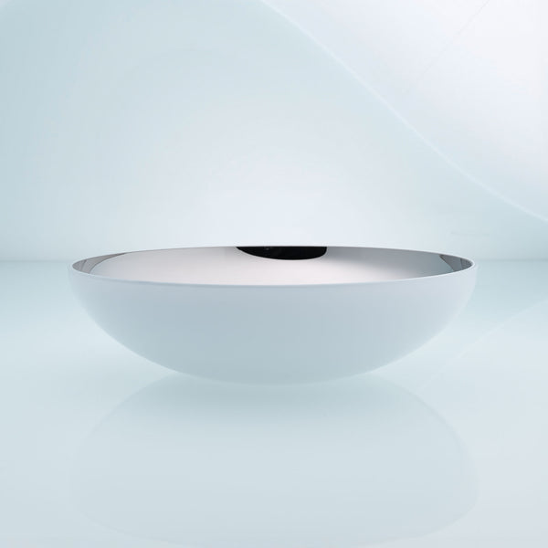 Flat round white glass fruit bowl with interior stainless steel coating. Mirror effect design glass bowl.