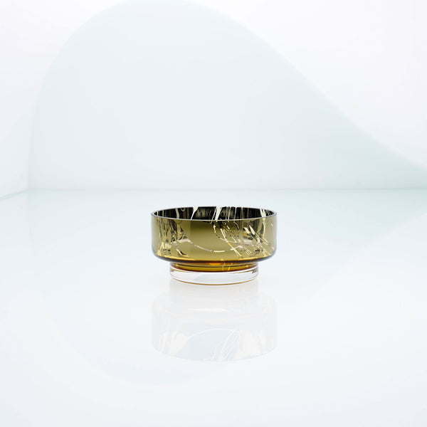 Mini, flat disk glass dessert or snack bowl in amber with metal interior coating and splashes. Designer hand made glass bowl.