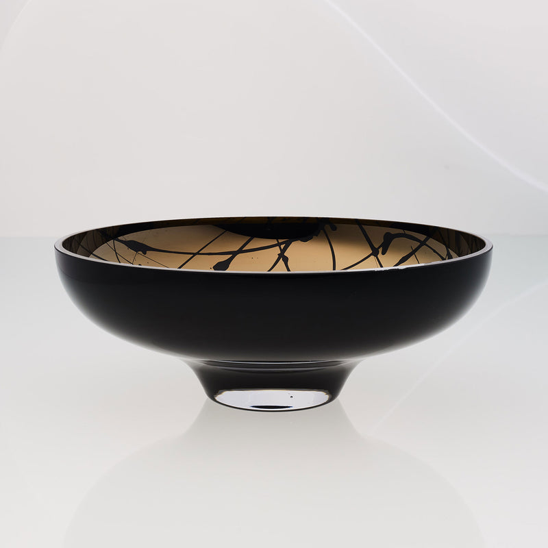 Round black glass fruit bowl on a stand with interior titanium coating and splashes. Mirror effect design glass bowl.