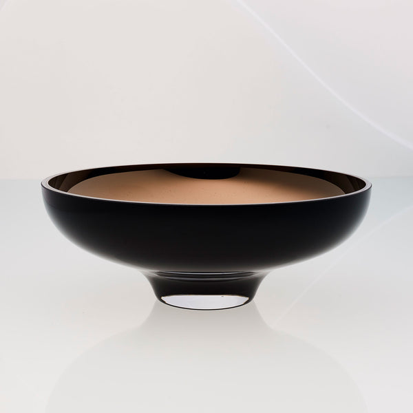 Round black glass fruit bowl on a stand with interior titanium coating. Mirror effect design glass bowl.
