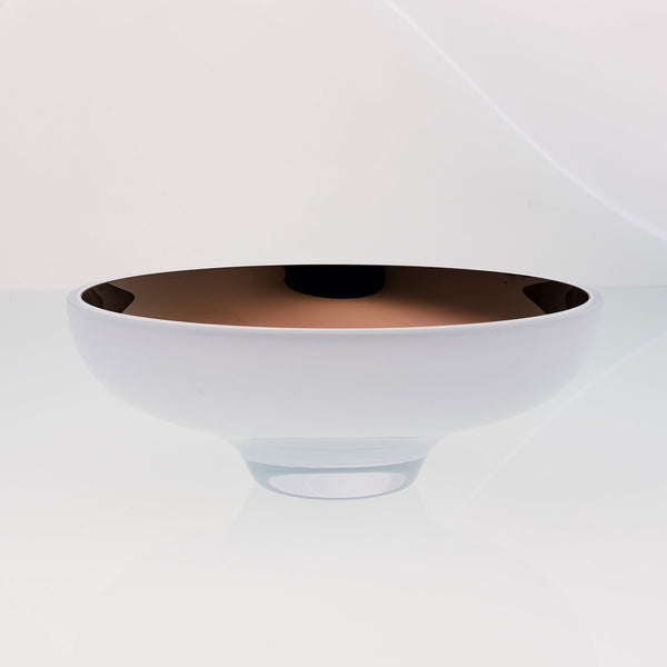 Round white glass fruit bowl on a stand with interior titanium coating. Mirror effect design glass bowl.