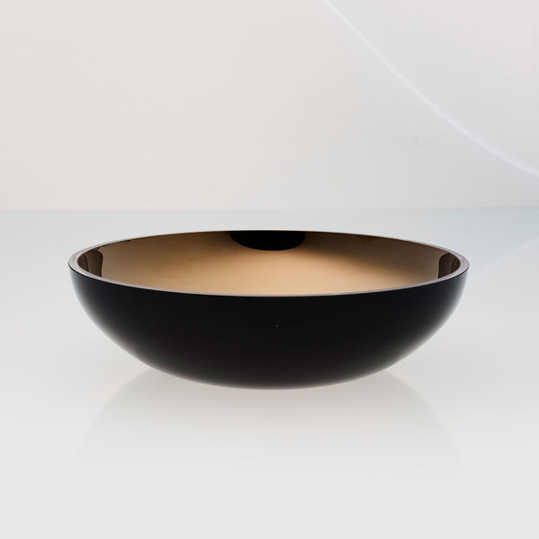 Round black glass fruit bowl with interior titanium coating. Mirror effect design glass bowl.