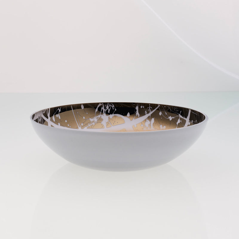 Round white glass fruit bowl with interior titanium coating and splashes. Mirror effect design glass bowl.