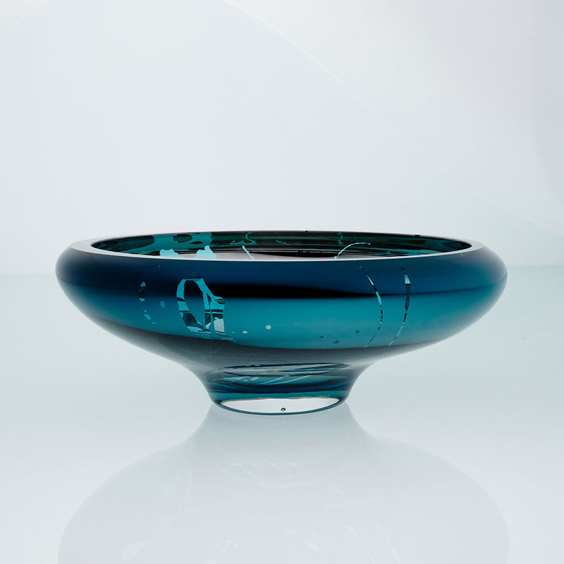 Teal blue glass bowl with splatter effect on a connected stand. Designer glass bowl with metal coating. Mirror effect glass bowl.