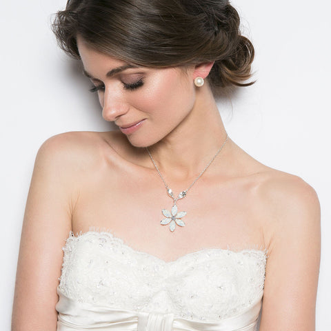ICEBERG (WHITEMOON). A dazzling Swarovski crystal flower necklace on a delicate silver chain accompanied by 2 sparkling Swarovski crystal petals and a rose pink crystal drop clasp.   A shimmering necklace which is perfect for all occasions. Available in a range of colours. www.jyjewels.com