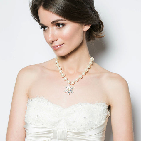 PAPILLON (CRYSTAL). A refined Cheshire cream pearl necklace with a dazzling Swarovski crystal flower centre. Fastened with a delicate silver chain and a sparkling rose pink Swarovski crystal drop clasp.  A beautiful twist on the standard pearl necklace. Available in a range of colours. www.jyjewels.com