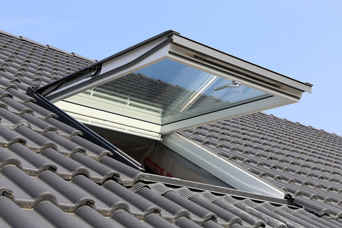 an outside view of a skylight on a residential roof