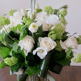 Flowers used: white roses, white lisianthus and green viburnum
