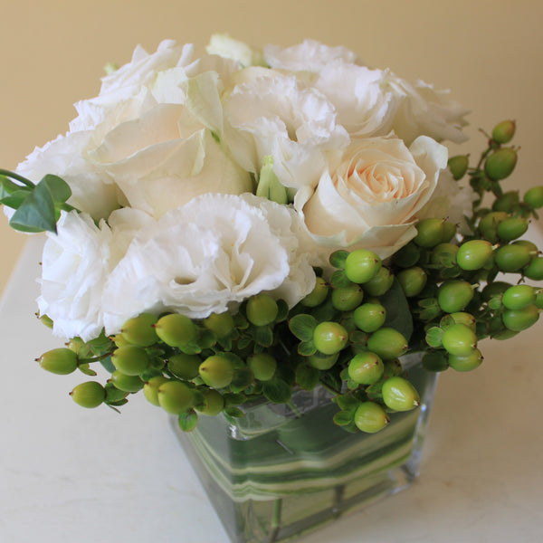 Flowers used: white roses, white lisianthus, green hypericum berries