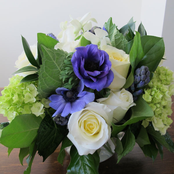 Flowers used: cream white roses, blue anemones, purple hyacinths, white orchids