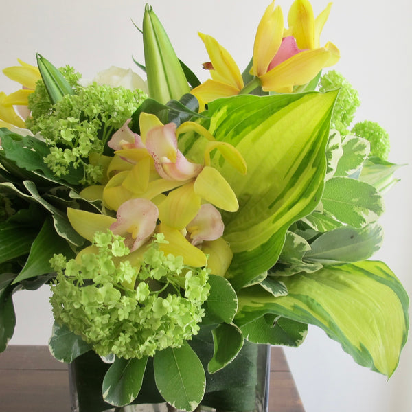Flowers used: white roses, green viburnum, white lilies, yellow orchids