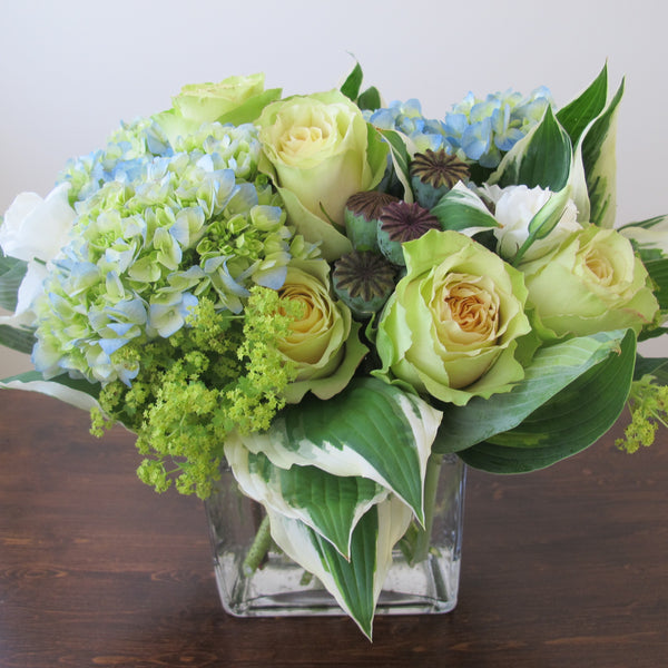Flowers used: chartreuse roses, white lisianthus, blue blush hydrangeas, chartreuse lady's mantles, poppy seed pods
