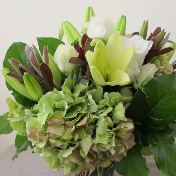 Flowers used: chartreuse lilies, green hydrangeas, white lisianthus
