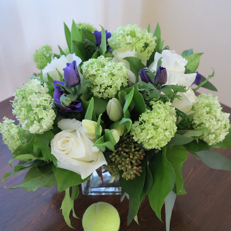 Flowers used: white tulips, white roses, green viburnums, blue anemones, seeded eucalyptus