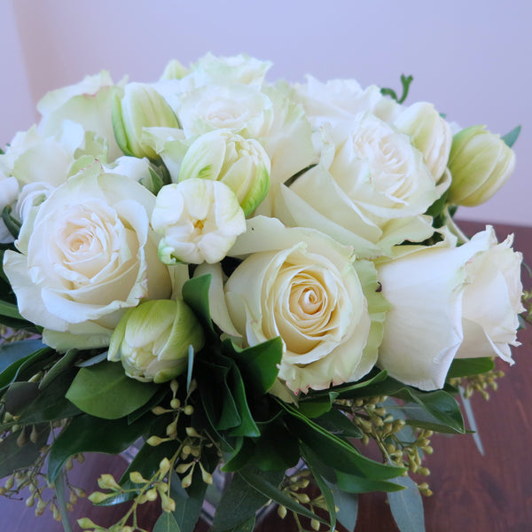 Flowers used: cream white roses, white ranunculus, white tulips