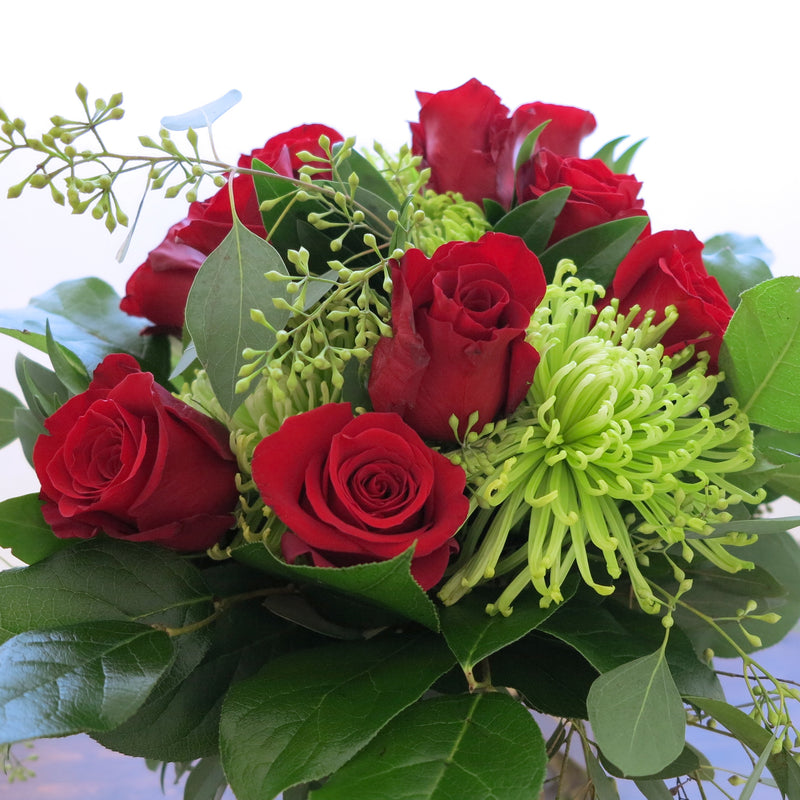 Flowers used: red roses, green chrysanthemums