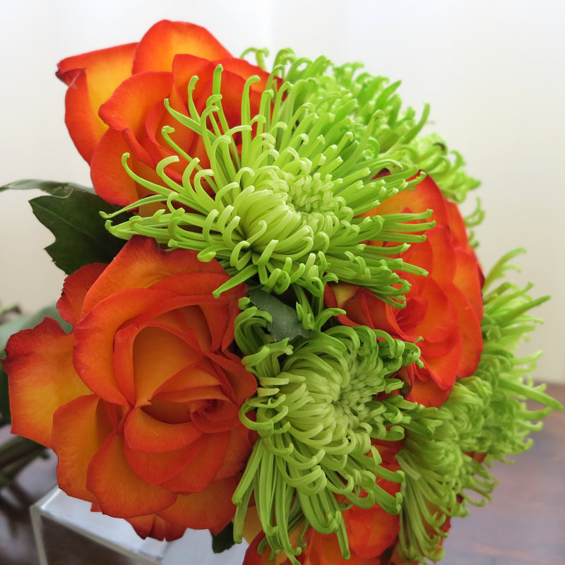 Flowers used: orange roses, green mums