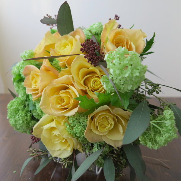 Flowers used: soft yellow roses, green viburnum