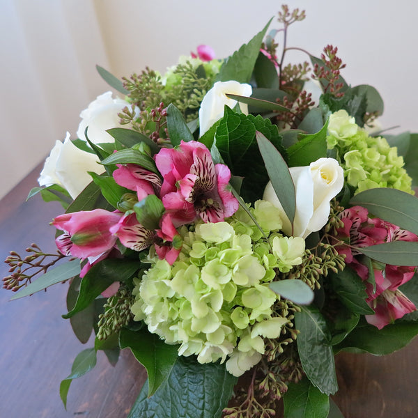 Flowers used: white roses, pink alstroemerias, green hydrangeas, seeded eucalyptus