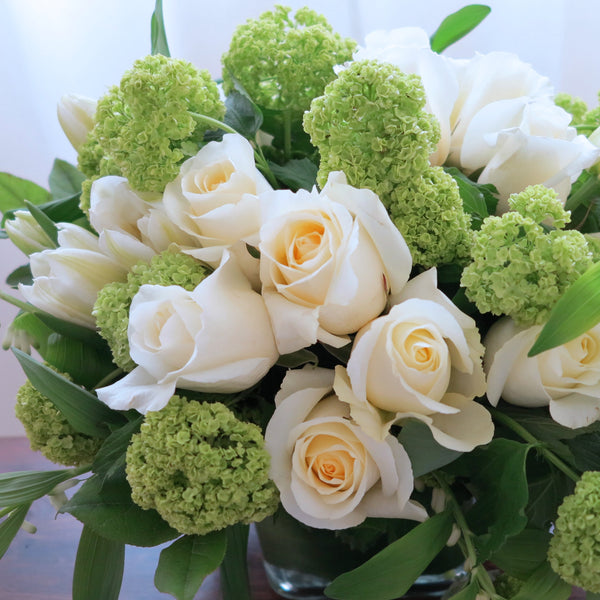 Flowers used: white tulips, white roses, green viburnums, white solomon's seals