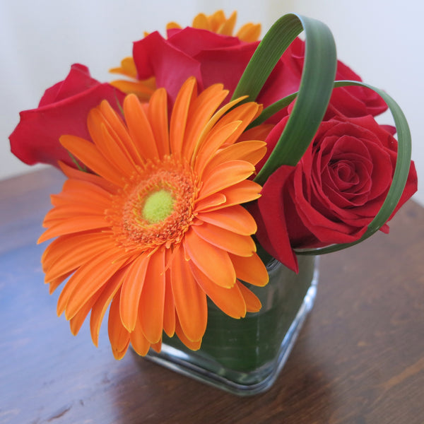 Flowers used: red roses, orange gerberas