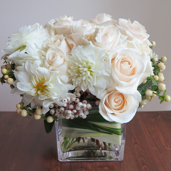 Flowers used: cream roses, white orchids and dahlias adored by white hypericum and dogwoods berries