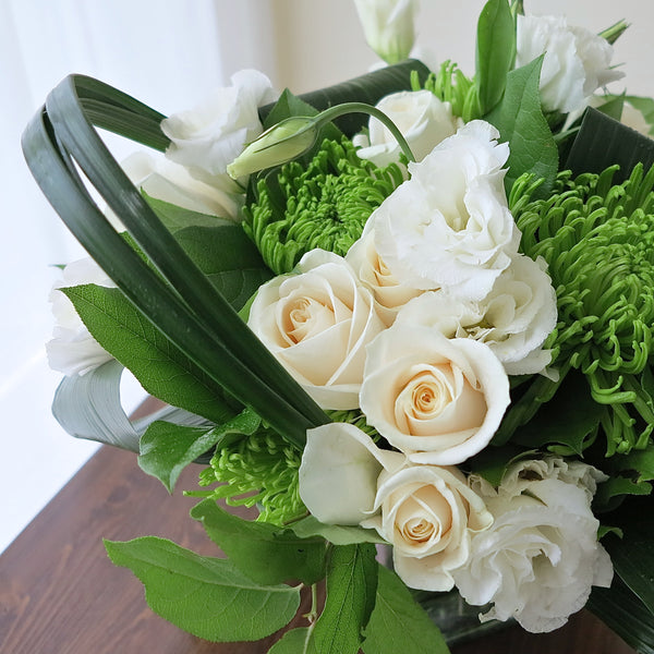 Flowers used: cream roses, white lisianthus, green chrysanthemums