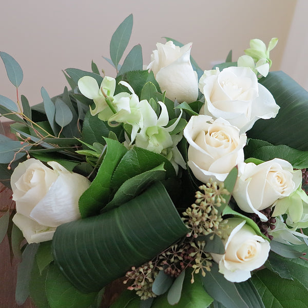 Flowers used: white orchids, white roses, seeded eucalyptus