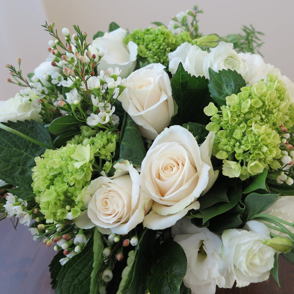 Flowers used: cream roses, white ranunculus and lisianthus green hydrangeas