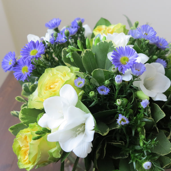 Flowers used: yellow/chartreuse roses, blue asters, white freesias