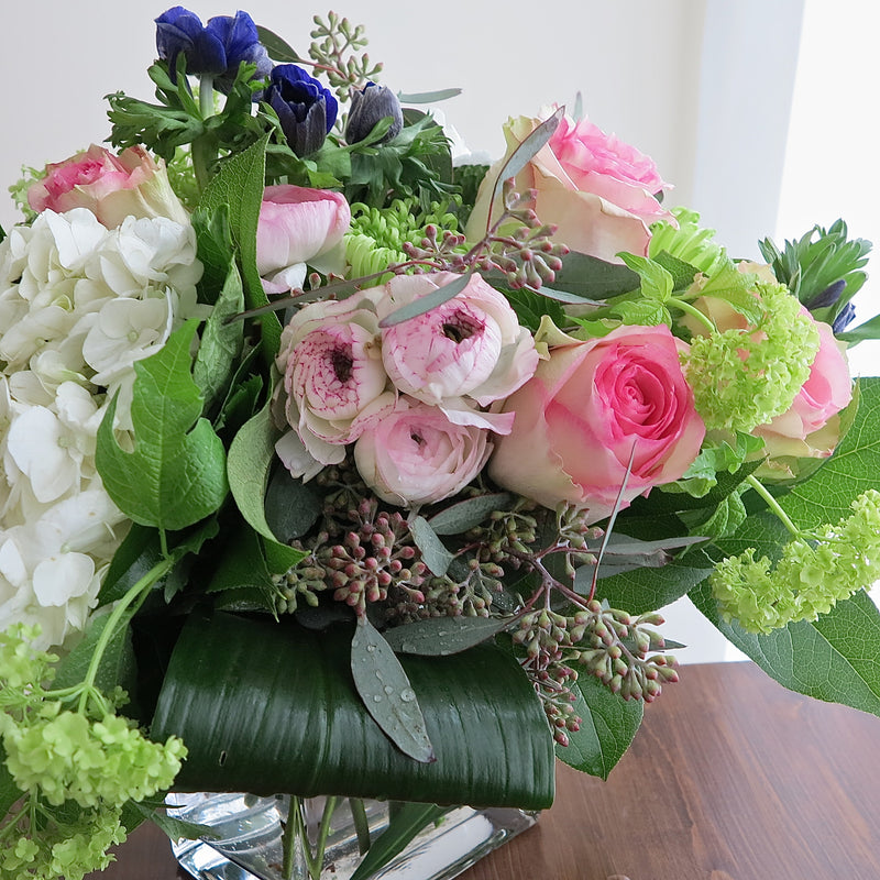 Flowers used: pink roses, blush pink ranunculus, purple anemones, white hydrangeas, green viburnums, green chrysanthemums, seeded eucalyptus