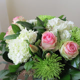 Flowers used: pink blush roses, green chrysanthemums, red tulips, white hydrangeas, seeded eucalyptus