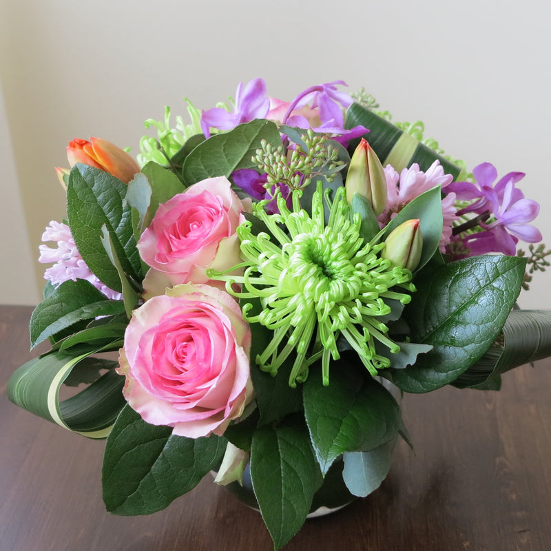 Flowers used: pink blush roses, green chrysanthemums, mauve hyacinths and orchids, red tulips, seeded eucalyptus