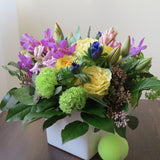 Flowers used: yellow roses, green viburnum, mauve hyacinths and orchids, red tulips, blue anemone