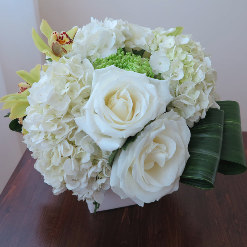 Cymbidium Orchids and Roses